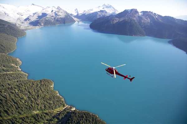 HELICOPTER FLYING TO BLACKCOMB TOP GLACIER